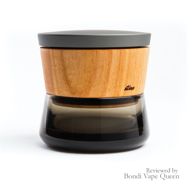 Stona Premium Herbal Grinder in a deep grey lid, Cherry Wood body and hand-blown glass.