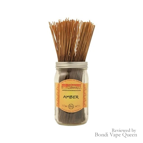 Pack of Amber-scented incense with red stem.